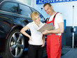 Car mechanic and customer looking at the repair costs