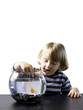 """USA, Utah, Provo, Boy (2-3) touching goldfish in bowl"""