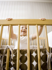 """USA, Utah, Provo, Portrait of baby boy (18-23 months) in crib"""