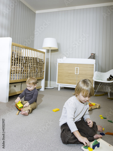 """USA, Utah, Provo, Two boys (18-23 months,2-3) playing in home"""