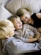 """USA, Utah, Provo, Boy and girl (2-5) in bed with mother"""