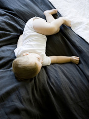 """USA, Utah, Provo, Baby boy (18-23 months) asleep on bed"""