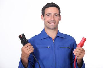 man car mechanic with alligator clips