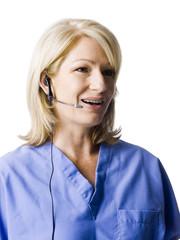 """Female nurse using headset, studio shot"""