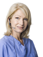 Portrait of female nurse using headset