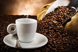 Fototapety Coffee smoking on the coffee beans background