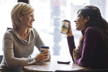Two women meeting in cafe