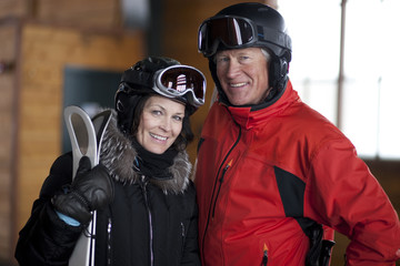 Portrait of mature couple going skiing