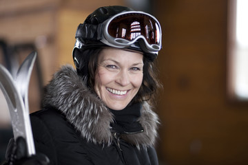 Portrait of mature woman going skiing
