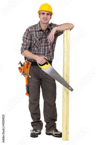 Casual carpenter stood with wood