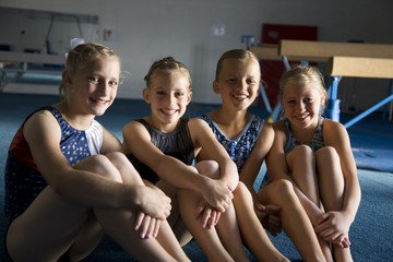 USA, Utah, Orem, Portrait of girls (8-11) resting in gym