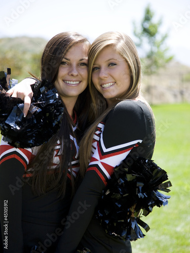 USA, Utah, American Fork, Portrait of two cheerleaders hugging