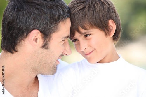a father and his son looking each other in the eyes
