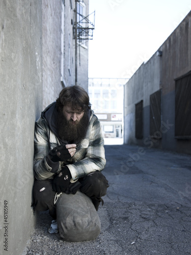 USA, Utah, Salt Lake City, Homeless man with sack by roadside