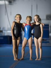 USA, Utah, Orem, portrait of three girls (8-9) in gym