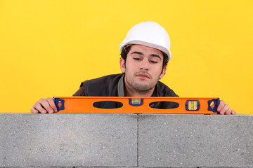 Tradesman using a bubble level