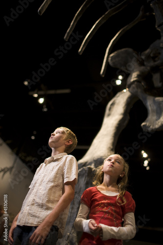 USA, Utah, Lehi, children (8-11) in museum of dinosaurs