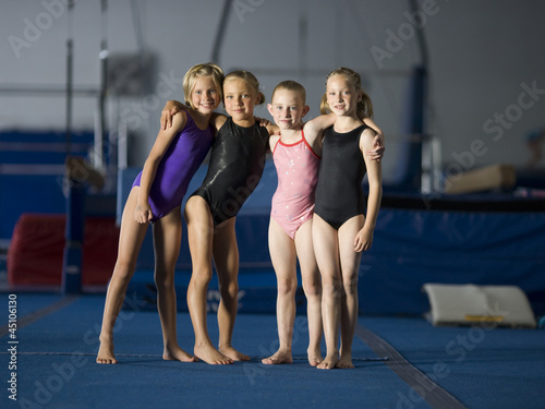USA, Utah, Orem, portrait of four girls (8-9) in gym