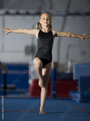 USA, Utah, Orem, portrait of girl (8-9) exercising in gym