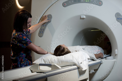 USA, Utah, Payson, Young woman during Magnetic Resonance Imaging