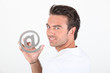 Man holding at symbol