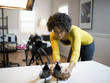USA, Utah, Orem, Young woman preparing high heels for photograph