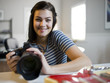 USA, Utah, Orem, Portrait of teenage girl (16-17) holding camera