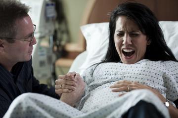 USA, Utah, Payson, Man assisting childbirth in hospital