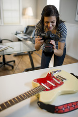 USA, Utah, Orem, Teenage girl (16-17) photographing guitar