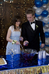 USA, Utah, Cedar Hills, Young couple pouring drinks at birthday party