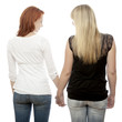 young beautiful red and blond haired girls holding hands back