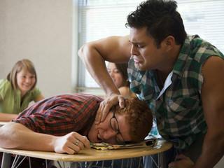 """USA, Utah, Young man bullying teenage boy (16-17) in classroom"""