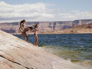 """USA, Utah, Young women standing near Lake Powell"""