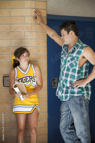 """USA, Utah, Teenage girl (16-17) with young man in locker room"""