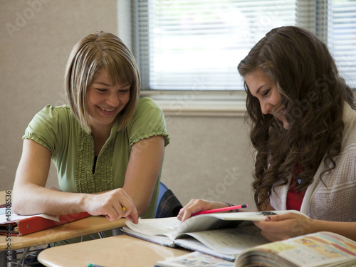 """USA, Utah, Two teenage girls (14-17) working in classroom"""