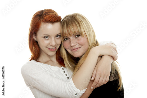 young beautiful red and blond haired girls are best friends