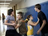 """USA, Utah, Spanish Fork, Four school children (16-17) fighting in school corridor"""