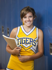 """USA, Utah, Spanish Fork, Portrait of school girl (16-17) holding notepad by lockers"""