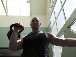 """USA, Utah, Draper, Man exercising in gym"""