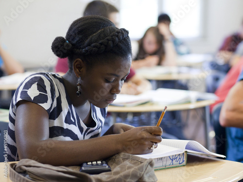 """USA, Utah, Spanish Fork, School girl (14-15) working in classroom"""