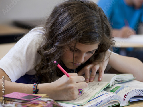 """USA, Utah, Spanish Fork, Female student (14-15) writing in notebook"""