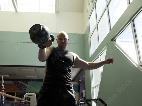 """USA, Utah, Draper, Man exercising in gym"""
