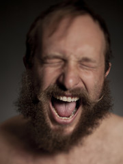Young man with beard shouting