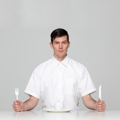Studio portrait of young man waiting for meal