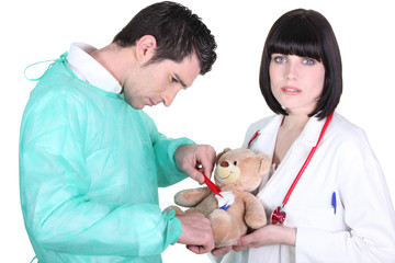 Doctor healing teddy bear