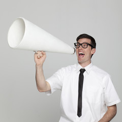 Studio portrait of young man with megaphone