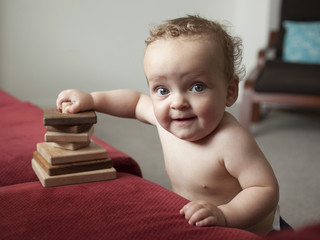 """USA, Utah, Orem, Shirtless baby (6-11 months) playing with wooden blocks"""
