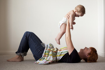 """USA, Utah, Orem, Mother playing with shirtless baby (6-11 months)"""