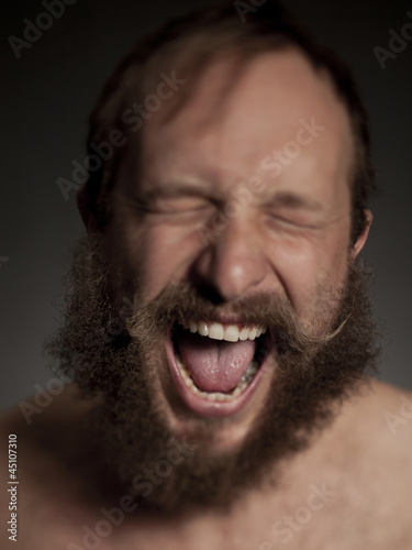 Young man with beard shouting