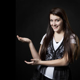 Studio portrait of teenage girl (14-15) gesturing